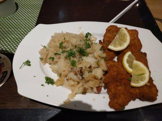 Newbury Park, Калифорния: Pork schnitzel dinner with warm potato salad and sauerkraut. Delicious!!
