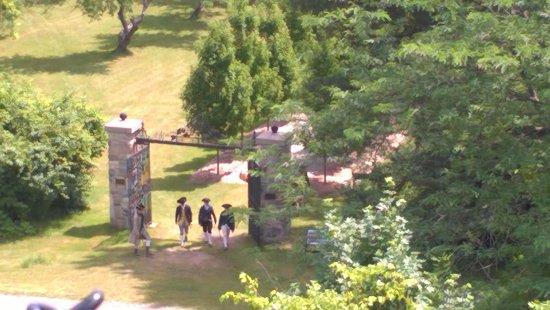 Some soldiers walking through the garden gates