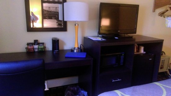 Marietta, OH: Desk with coffee and coffee pot. Microwave and fridge under TV.