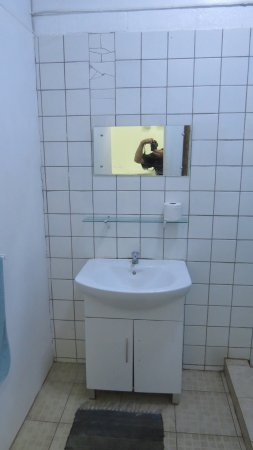 Upolu, Samoa: bathroom sink with rotten and smelly mat