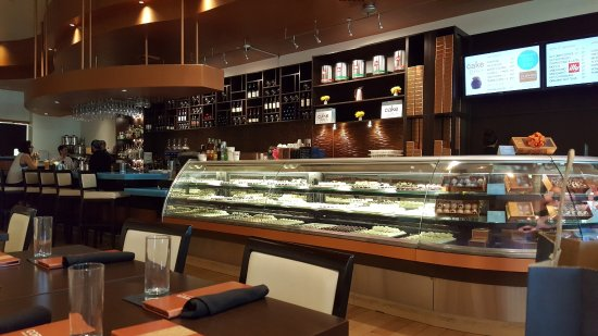 Copper Restaurant Dessert Lounge S Inside View Cake Display Case And Bar Setup