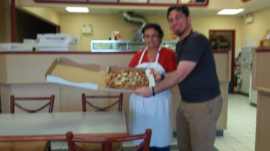 Oshawa, Canada: Here I am with one of the staff members showing off my Pizza! Saturday, July 16, 2016