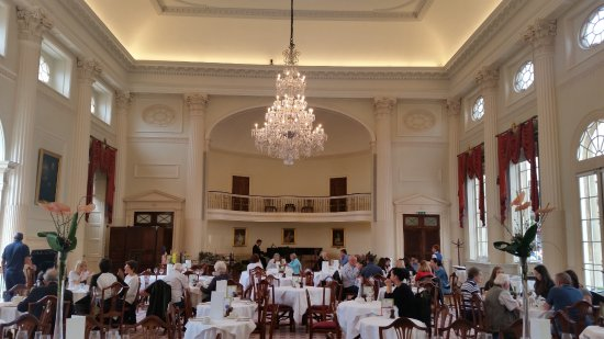 West side wall including chandelier and piano player - Picture of ...