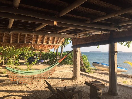 All rooms are off the ground with hammocks & swing beds below