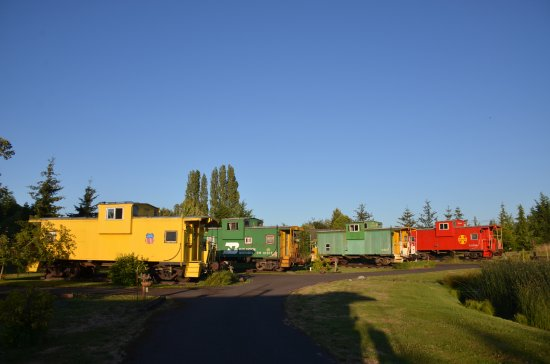 Red Caboose Getaway: The Lavender Express is the nearest caboose: yellow outside, lavender inside.