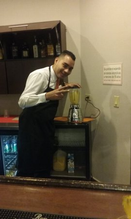 Holiday Inn Panama Canal: My waiter standing by the piña colada