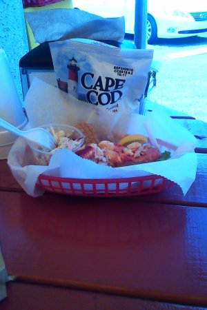 Lobster Roll and Cape Cod potato chips on the picnic table prior to consumption