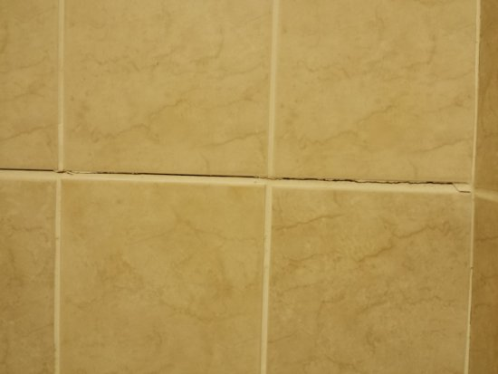 Econo Lodge : they attempted to redo bathroom....cracked grout