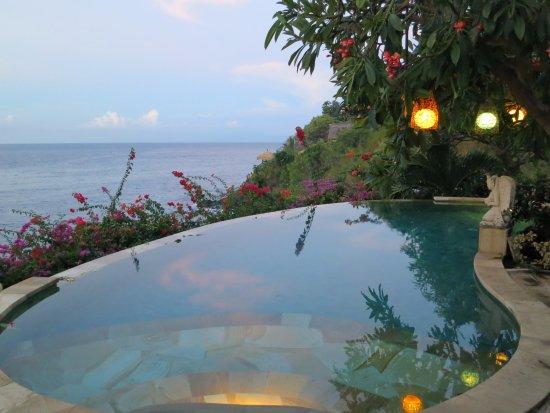 Blue Moon Villas: Pool at dusk