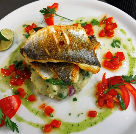 Amigos Restaurant and Roof Terrace: Pan seared gilt head bream fillets on top of crushed potato combined with wilted baby spinach &
