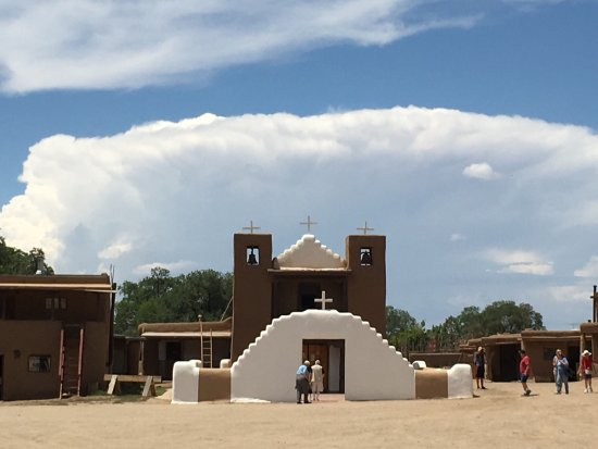 Timeless and enduring Taos Pueblo a community of 2000 stands in the shadow of the Sangre de Cris