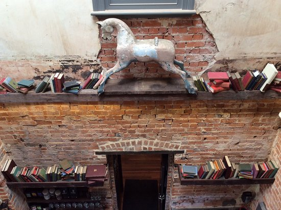 Guildford, Australia: Old rocking horse and books.