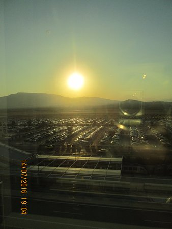 Spata, Yunani: Sunsets over the car park and runway, Athens airport Sofitel