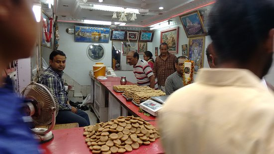 "Deoghar, India: Mostly sweets made up of ""khua"" are offered as prasad to the temple"