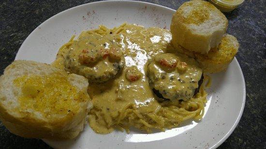 Westwego, LA: Delicious crab cakes with crawfish and creamy spaghetti noodles