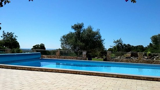 Moncarapacho, Portogallo: View from the covered terrace of pool, garden, countryside and coast.