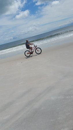 The Suites at Americano Beach: Hubby riding bike on the beach!