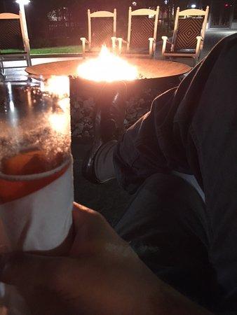 Stevensville, MD : Enjoying drink by the firepit.