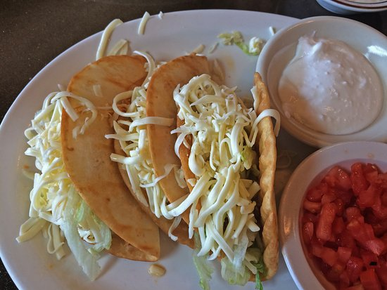 West Branch, IA: Tacos supreme with tomatoes, sour cream, lettuce and shredded cheese