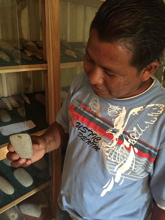 Belmopan, Belize: Our guide, Cesar, showing off some artifacts in the museum