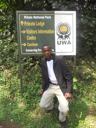 Fort Portal, Uganda: the poster cleary welcomes you to the primate capital, kibale national park