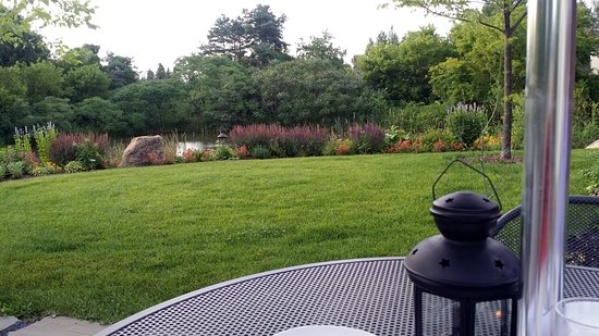 North Ferrisburg, VT: Our table on the patio looking over the pond