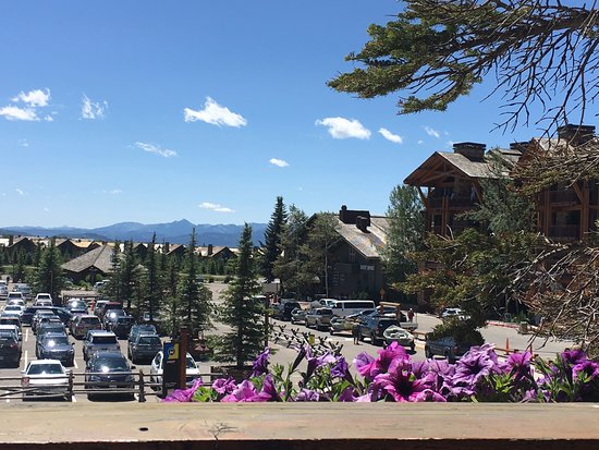 Teton Village, WY: view of parking lot and mountains from patio