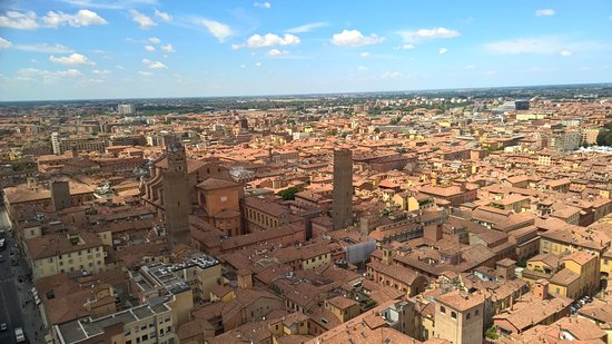 Torri Degli Asinelli E Garisenda: The City With Red Roofs. Bologna Is An  Enchanting