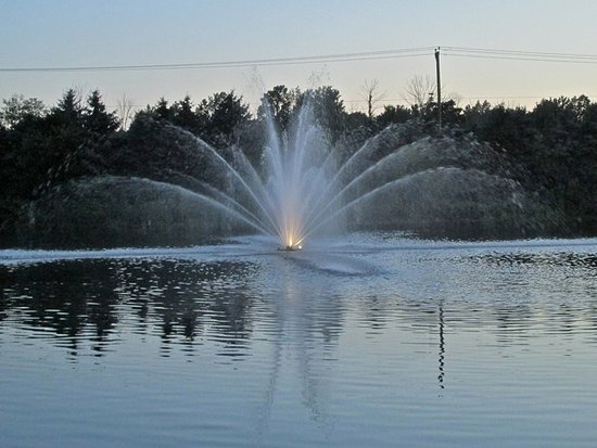 Lewis Center, OH: twilight and one of two fountains in the lagoon near the dining area