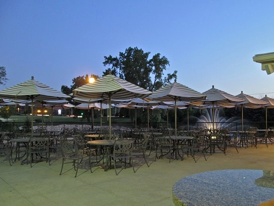 Lewis Center, OH: twilight outside dining area between the pool anf the lagoon