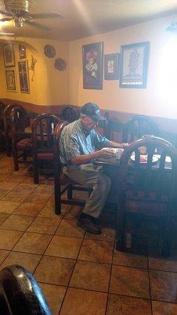Ranchway BBQ & Mexican Food: Mr. Rodriguez sitting down to enjoy his food in his own restaurant - what a wonderful man!