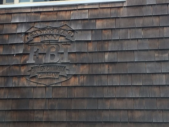 Emblem etched into the cedar shingles, Fanny Bay Inn