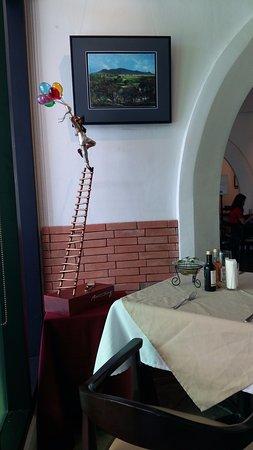 Italia Restaurant: Statue by Michel Cacnio