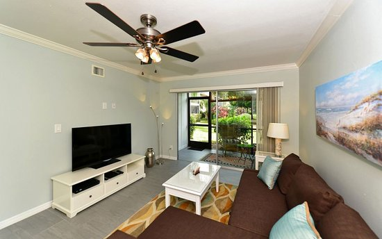 White Sands Village: Living room of unit 303. Comfortable sleeper sofa, Xfinity on 50inch TV and beautiful garden vie