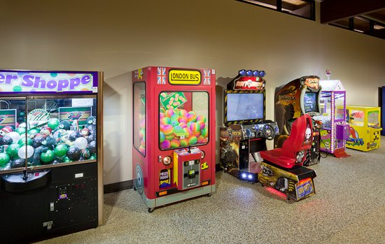 The indoor pool at the Best Western Plus hotel in Shoreview, MN has vintage arcade games for som