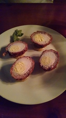 Lock Haven, PA: Scotch Eggs - 2 hard boiled eggs, wrapped in sausage, breaded & fried, served with spicy mustard