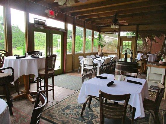 Calera, AL: Enclosed porch dining