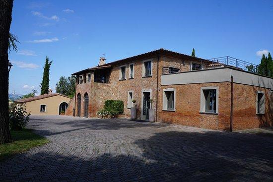 Petrignano, إيطاليا: Main farmhouse. Now spa on right, 2 apartments above & resturant on left. 