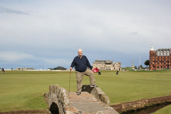 Dunfermline, UK: Standing on the famous Swilcan Bridge on the 18th fairway of the Old Course.