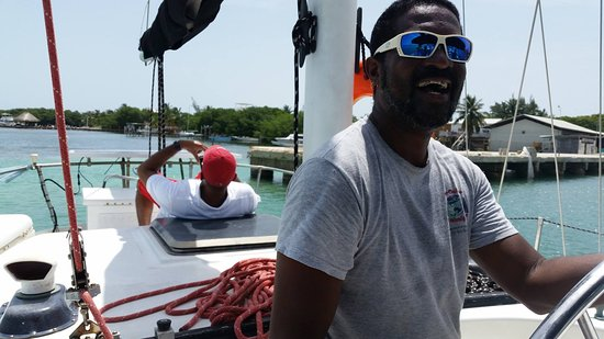 Caye Caulker, Belize: The captain and the boat.