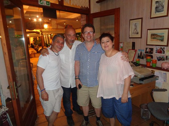 Ellados Gefsis : My husband and I with owner Litsa and host Georgios.