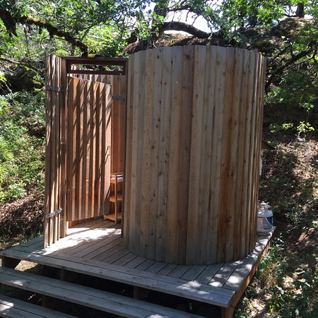 glamping area, outdoor circular redwood shower, with tankless water