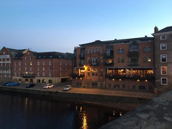 Reubens Court Apartment: The apartment from across the Ouse river.