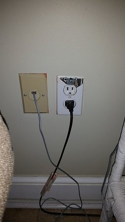 Inn at Camachee Harbor: More dirt on top of already nasty. Check out that outlet plug. That looks safe.