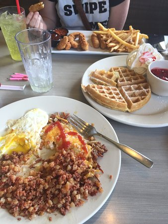 Little Falls, MN: Corned beef hash and eggs with a strawberry waffle!