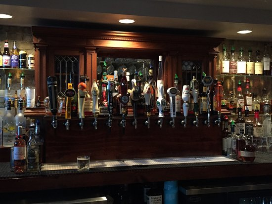 Oconomowoc, WI: Wonderful selection of tap beers, wine and Irish whiskey's! Beautiful Pub area