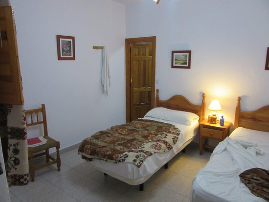 Hostal Rural Atalaya - A twin room (sorry about the mess)