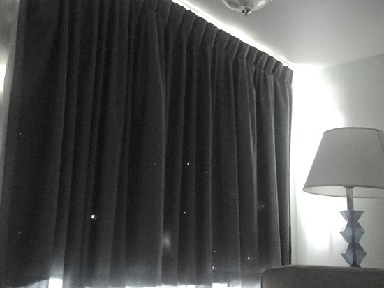 Marguerite Motel: Our starry night curtains- How do curtains get holes like this in a non-smoking room?