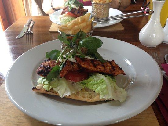 Deganwy, UK: Cajun Chicken, watercress, lemon mayonnaise, lettuce & tomato on ciabatta with chips.
