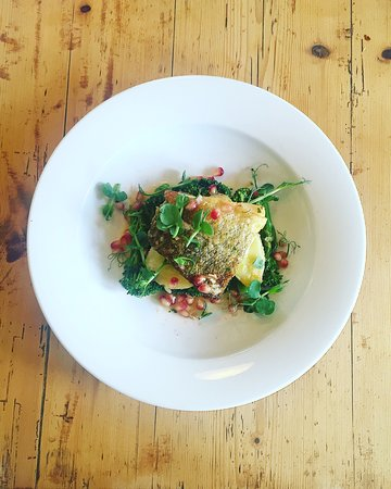 Wymondham, UK: Roasted cod fillet with tender stem broccoli and new potatoes. Serves with a lemon and pomegrana